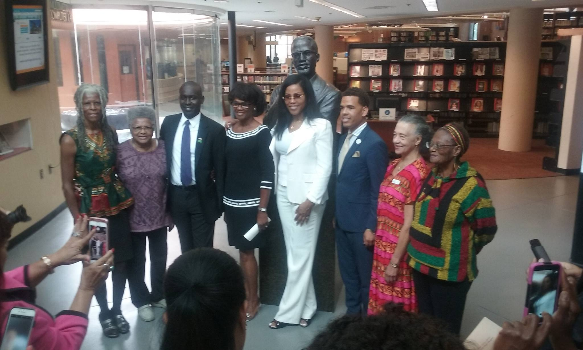 Malcolm X's daughter makes her 1st visit to the library